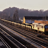 73106 hauls a long rake of YCV Turbot wagons into Woking yard on a cold winters afternoon.