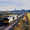 58002 / 58003 run north through Kings Sutton in beautiful evening light with a rake of empty coal hoppers from Didcot  9 November 1991