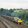 33202 'The Burma Star' in engineers 'Dutch' livery passes West Byfleet bound for Woking Yard.