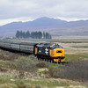 37418   'An Commun Gaidhealach' near Achanalt<br /> with the 10.50 Inverness - Kyle of Lochalsh<br /> <br /> 10 June 1986