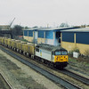 56033 thunders through Slough with a rake of ARC hoppers for Acton