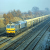 59001 'Yeoman Endeavour' in original livery, with 'Bell End' leading, takes a jumbo rake of hoppers back to Merehead. <br /> Seen here passing Milley Bridge in rather foggy conditions