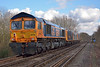 GBRF  loco convoy 0Y19 12:23 Hoo Junction Up Yard to Eastleigh East Yard  formed with ED's 73136 / 73107 / 73141 and   66730 on the tail pass Trumps Mill, Virginia Water<br /> <br /> 1 March 2014