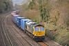 66570 is at the head of a late running  4O49  Crewe  to Southampton Maritime freightliner as it approaches Tilehurst.<br /> <br /> 4 March 2014